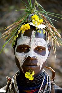 Karo woman with floral headgear, Omo Valley, Ethiopia