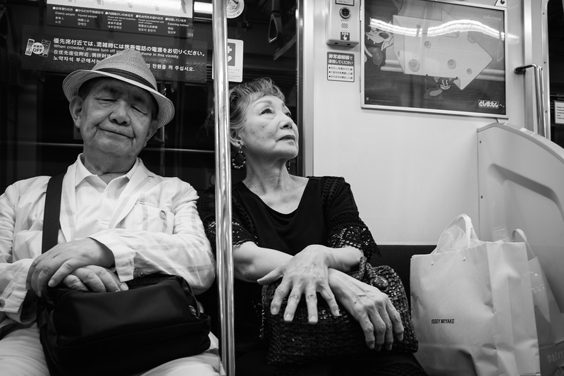Heading home - an elderly couple on the Tokyo subway late at night.