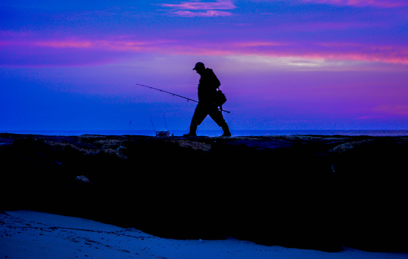 A Fisherman on a Jetty at the Shark River Inlet, Belmar, NJ