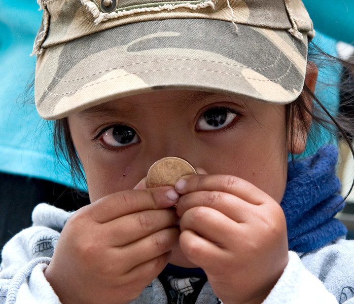 Ecuadorean Girl with Coin Quito, Ecuador