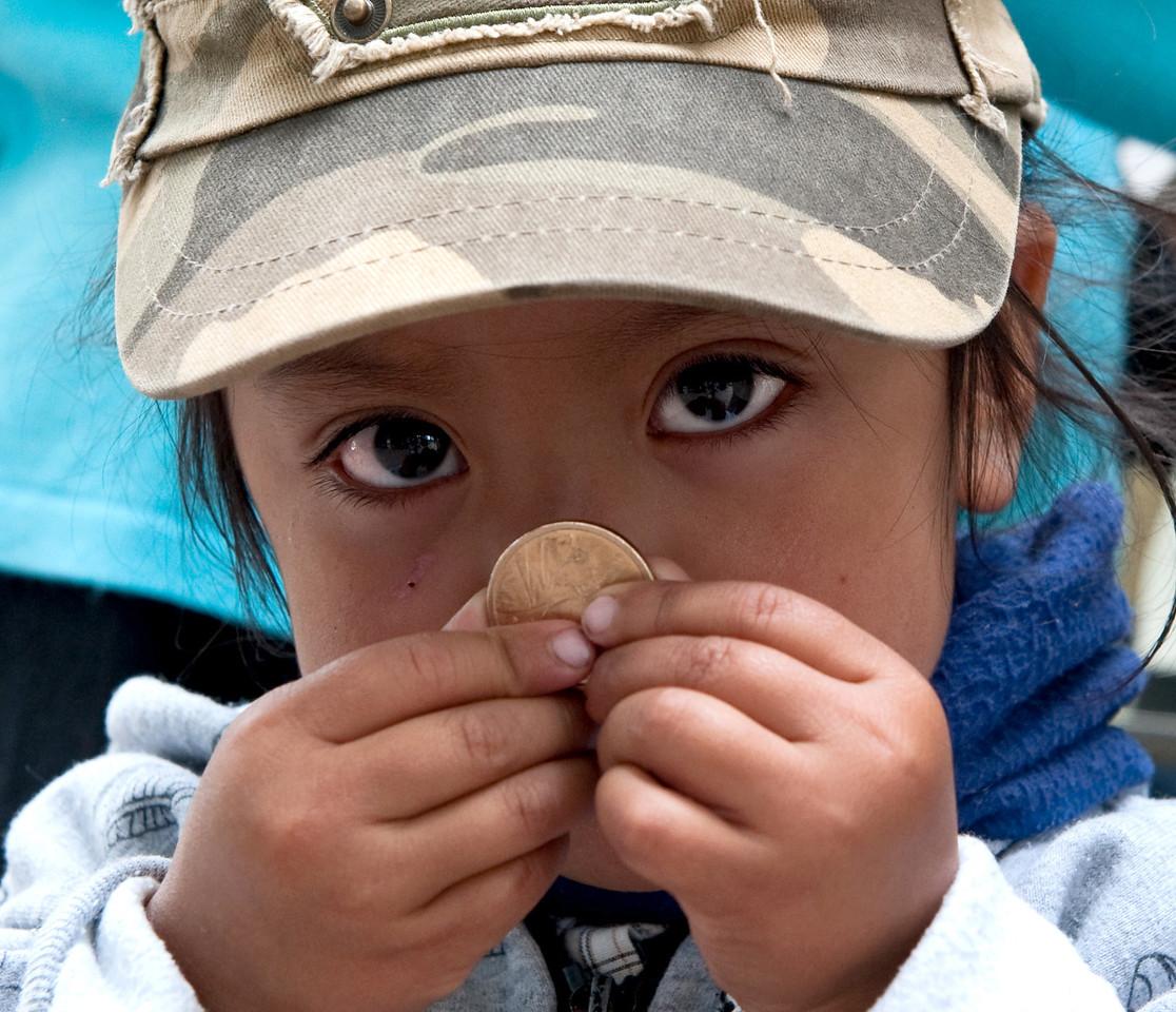 Ecuadorean Girl with Coin Quito, Ecuador