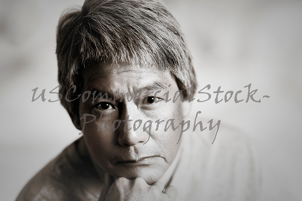 Portrait of a Chinese Man resting his Chin on his Hand