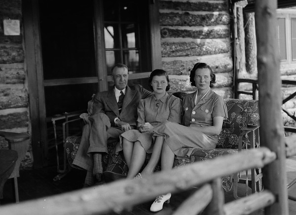Lovely shot of the family on the porch of the cabin, which can be seen from the exterior in another shot in this gallery.