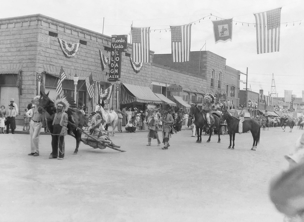 Parade, 1930s, Monte Vista, CO. Dig the 48 star flags.