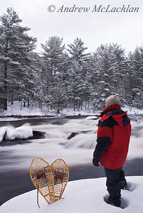 Adult Male and Snowshoes in Winter on the Muskoka River, Bracebridge, Ontario, Canada