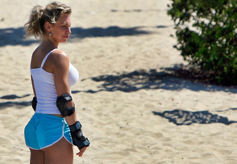 Woman skater on the boardwalk at venice Beach, California