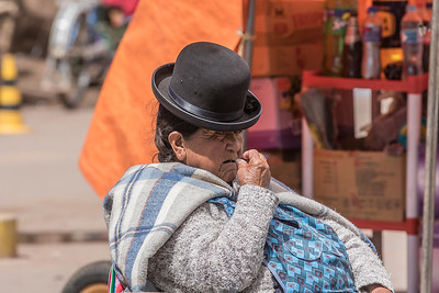 Angry Uros woman on the Bolivian/Peruvian Border in Desaguadero, Peru