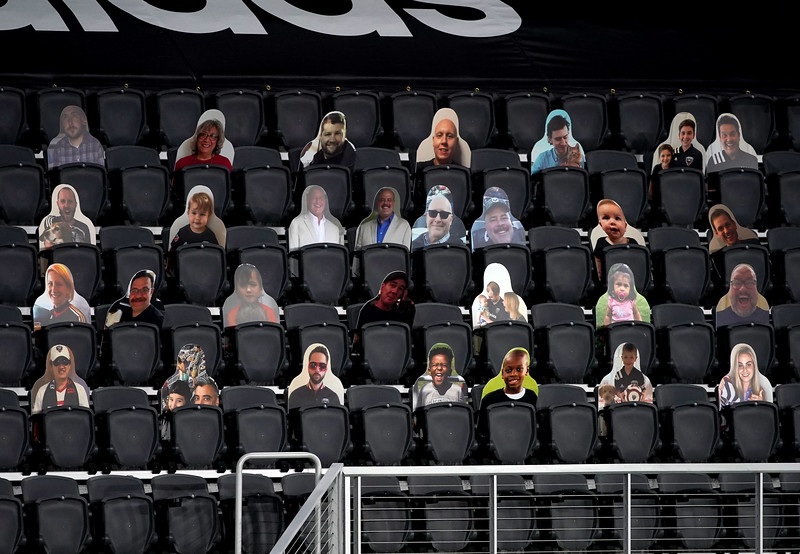 Cardboard fan cutouts in a Covid 19 stadium closed to fans.