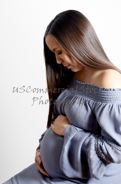 Pregnant Woman with Hands on Tummy