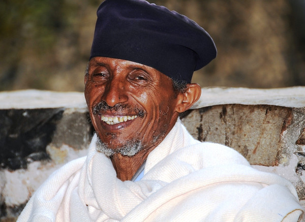 Smiling Priest Outside Church in Ethiopia