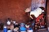 Acholi Woman Washing Dishes, Mbuya Slum, Kampala, Uganda