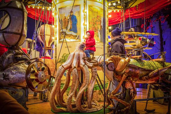 Child Riding Squid On Merry Go Round - Brussels, Belgium