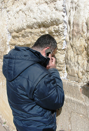 Praying andTalking on Mobile Phone at The Wall, Jerusalem, Israel