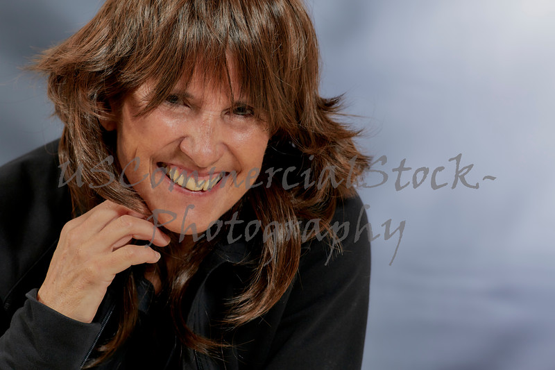 Attractive Woman with Brown Layered Hair and Smiling