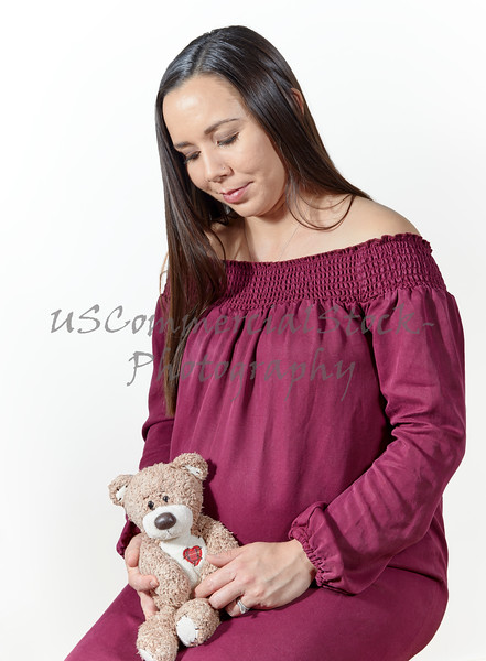 Pregnant Woman holding a Stuffed Bear