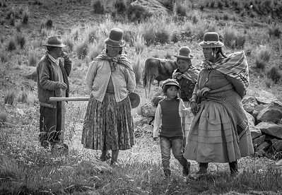 Uros People of Southern Peru finishing a hard days work in the Quinoa, fields.