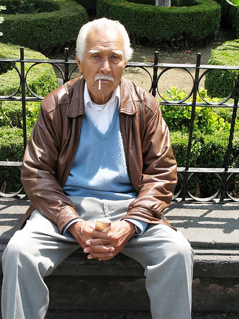 "While walking through a park in Mexico City, I began to talk with this ""pensioner"" and he gave me permission to phogoraph him."