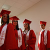 """As """"Pomp and Circumstance"""" is played, soon-to-be-graduates Jordan Rogers, Bailey Reynolds, Megan Redman, Tyler Quintana and Josh Pugel file into the auditorium for West Jessamine's graduation ceremony."""