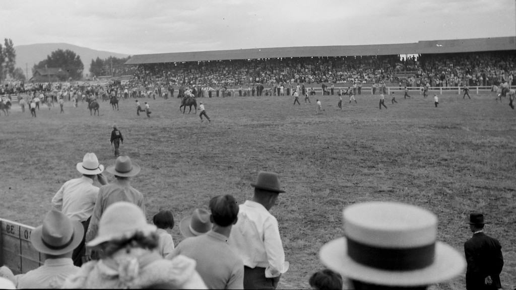 Rodeo or something. Whatever it is, it looks like the most chaotic rodeo ever. 1930s probably.