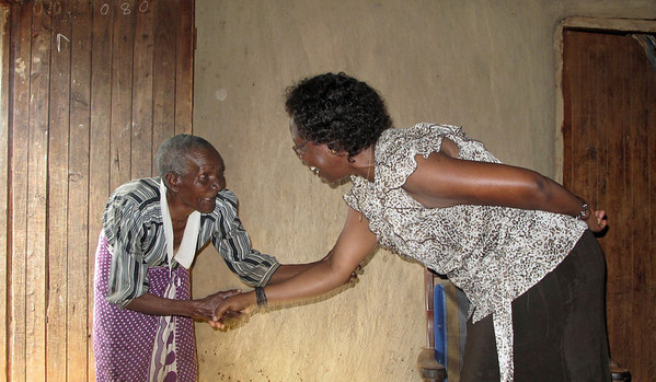 Monica Greeting Elder in Alego