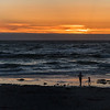 Mother and Child Share the Last Minutes of Daylight on the Beach, Asilomar State Beach, California
