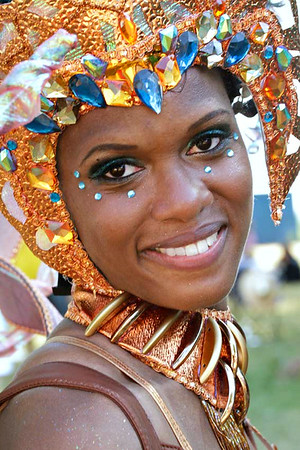 Young woman smiling with sparkling headdress.