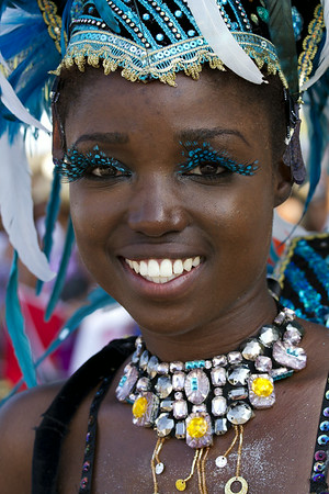 Girl with feather eyelashes and Caribana parade costume