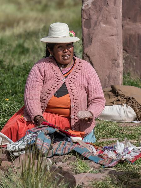 Uros Woman sitting near the Puerta de Hayu Marca selling rocks