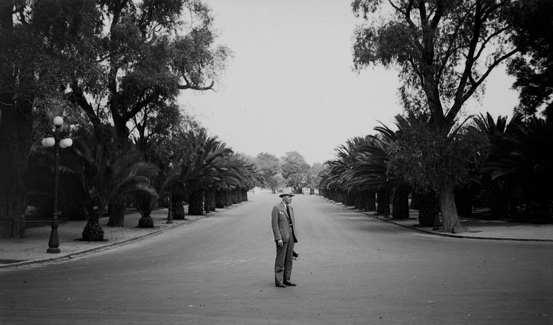 Possibly Mexico, 1930s, based on the other photos in the same batch. He's holding a camera.