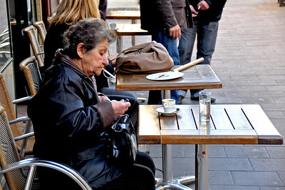Woman Starting Her Day With Espresso and Cigarette. Avignon, France.
