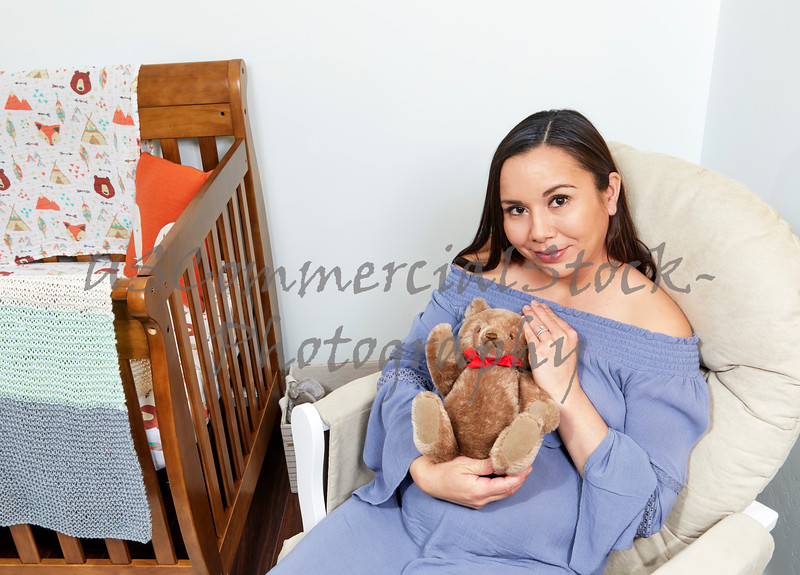 Pregnant Woman sitting in Chair