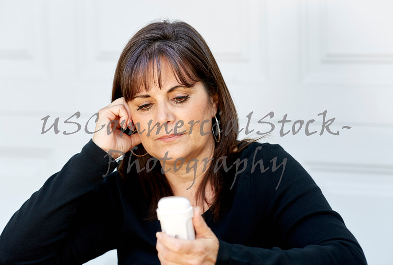 Attractive Woman looking at Portable Phone