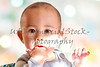 Cute baby boy with finger in mouth