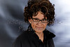 Middle Aged Woman with Curly Hair wearing Reading Glasses