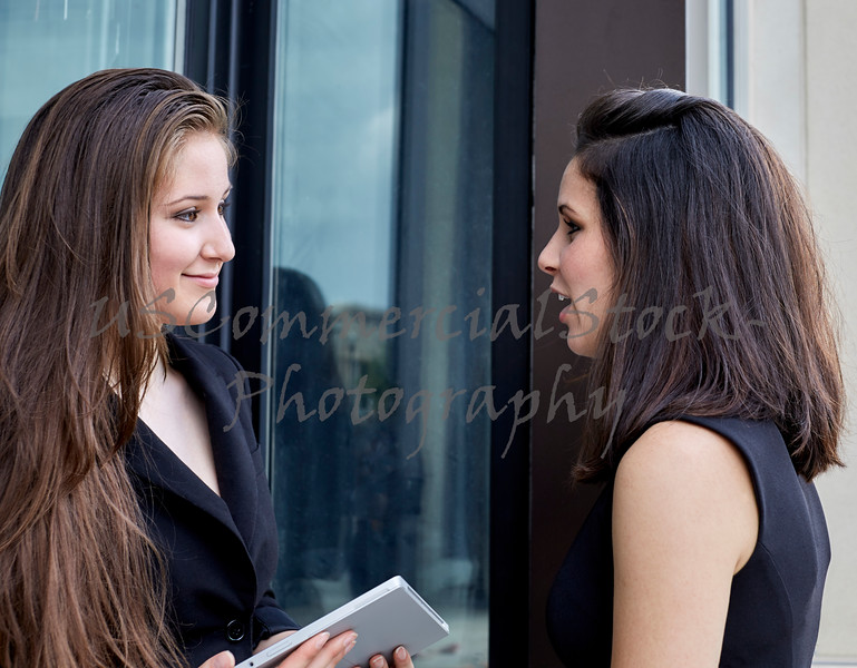 Two Young Women having a Conversation and Smiling