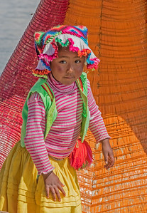 This little Uros girl was acting as the navigator on her reed boat, Lake Titicaca, Peru