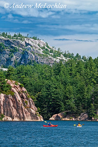 Women Kayaking on George Lake in Killarney Provincial Park, Ontario, Canada