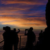 People taking iPhone photos of the sunset along the Cinque Terre coastline on the Via dell'Amore, Manarola, Cinque Terre, Italy