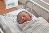 A New Born Infant in a Hospital Crib