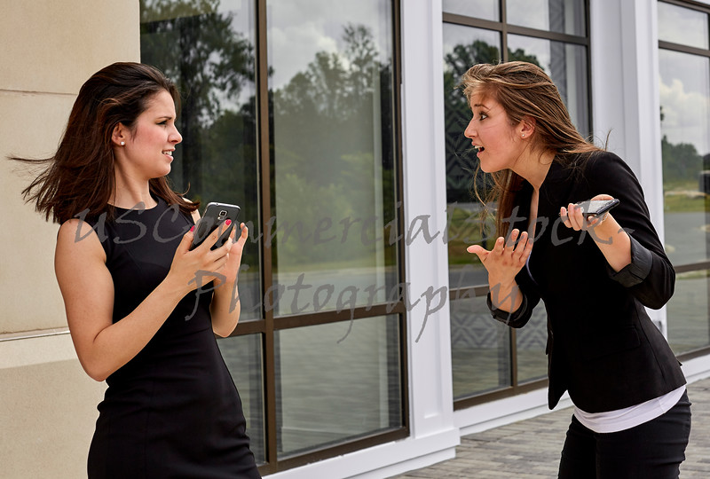 Two Young Women arguing over a Broken Cell Phone