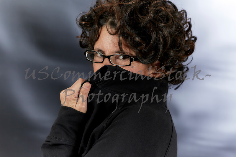 Middle Aged Woman with Curly Hair wearing Eyeglasses