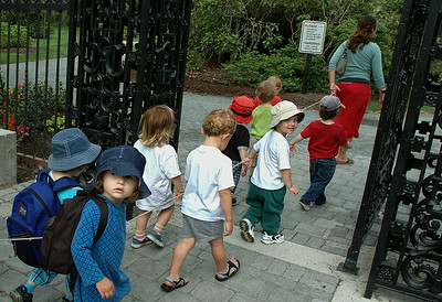 Preschoolers walk in the garden