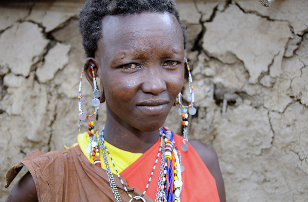 Young Woman Wearing Goatskin Clothing, Maasai Mara, Kenya