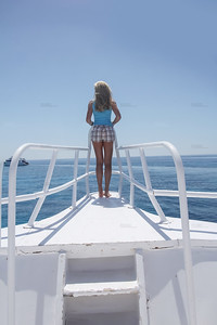 Blond sey model posing on the bow