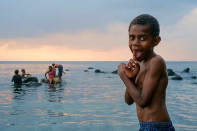 Vanuatu, Paama, Children enjoying evening swim