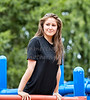 Young Woman exercising on outdoor equipment