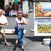 Selling artwork in Piazza Navona, Rome