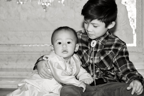 A toddler and a Young boy in Black and White