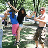 From left, Sierra Hensley, Cassandra Mast, Estefania Pena and Miha Juvan tried out slackline equipment between trees in Triangle Park. Hensley, Mast and Pena were downtown with Stars, a camp for teen girls in Cardinal Valley. Juvan is a professional slackline demonstrator from Maribor, Slovenia. Promotional demonstrators from the Gibbon company set up slacklines at Shilito Park and Triangle Park on Tuesday, July 14, 2009. Several Lexingtonians tried out the equipment. Photos by David Wheeler.