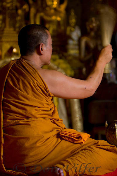 Monk giving blessings at temple in Northern Thailand.